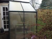 Greenhouse polycarbonate with green aluminium frame.