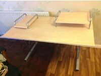 Sturdy, metal framed office desk with light wood surfaces. 91 cm tall, 135 cm wide and 85 cm deep.
