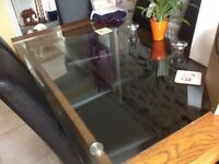 Glass top dinning table.