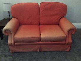 Red 2 seater settee in need of covering
