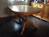 Pine extendable dining table for sale. (63in extends to 80in). Chamfered edge with curved ends