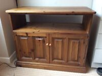 Wood TV stand and cupboard.