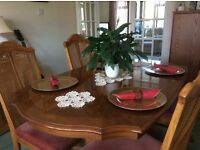 Dining table in Yew, extends, 4 dining chairs