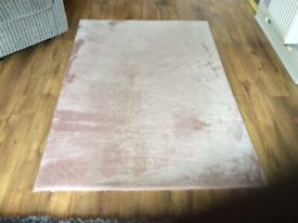 Pink fluffy rug.