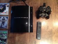 PlayStation 3 with two controllers & 7 games