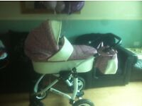 White and pink leather pram