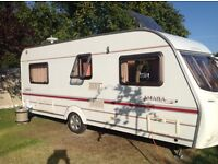 Coachman Amara 530/4 four berth caravan with fixed end bedroom. Supplied with full awning