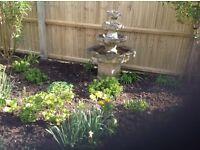 large stone garden fountain