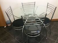 Glass top dining table and 4 chairs black/chrome