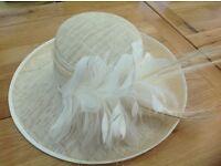 Cream wedding hat with cream feathers