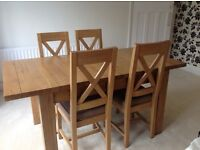 Solid oak extendable dining room table with 4 chairs