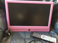 Pink flatscreen TV DVD combination, wall bracket and remote