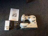 Signature mini sewing machine