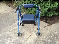 Walker with seat and storage for handbag etc