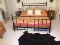 Very large furnished room with enormous comfy grand kind size bed,