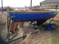 Wooden Yacht, built 1950, brand new road trailer and spare jib.