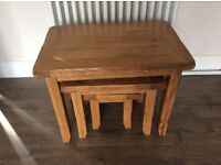 Solid oak nest of three tables. Matching coffee table also available, being advertised separately.