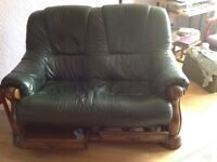 2x oak based green leather two seater sofas with 2 drawers in base