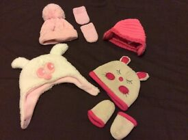 Selection of baby hats and mitts