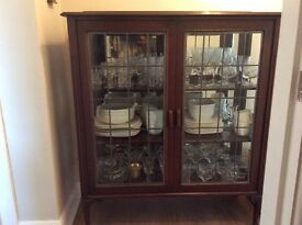 Solid wood antique display cabinet.