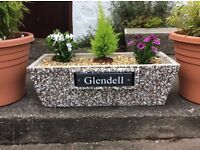 Concrete rectangular planter / pot with slate engraved house sign. Exposed stone finish