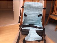 Child's strap to a chair safe and sound booster seat easily packs down for traveling
