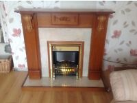 Mid oak fireplace with electric fire and coal burn effect and flame