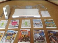 Nintendo Wii Fit Plus with balance board, 2 x controllers and 10 games: