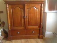 Large wooden t v cabinet and storage.