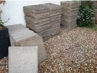 Heavy duty concrete paving (patio) slabs, very light speckled grey in colour.