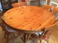 48inch round solid pine tilt top table and four chairs
