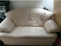 2 x cream leather sofas - each is 2 seater - excellent quality