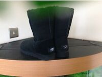 For sale 1 pair of original ugg boots in black size 7 ankle style.