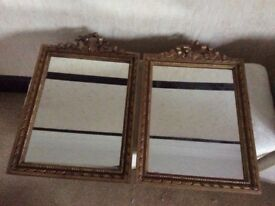 A Pair of Mirrors. Gilded hand carved frames