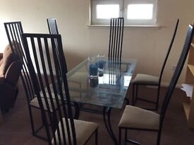table and six chairs , 3 seater recliner couch , toastekettle microwave, 4 x living room tables