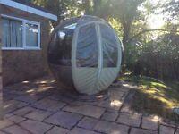 Rotating garden sphere seater