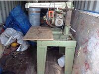 The saw is a Dewalt 3 phase cross cut saw