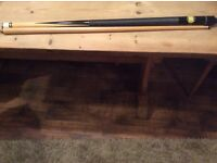 Snooker cue unwanted present unscrews into 2 pieces
