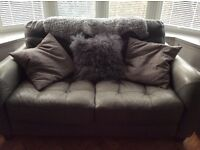 Grey Leather 2 seater DFS sofa and footstool with storage