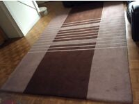A Extra large rug .....3m x 2m used but with a gentle clean could look goo as new.