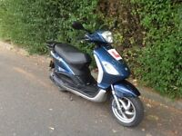 PIAGGIO FLY 125 FULLY SERVICED 12 MONTHS MOT LOW MILES IDEAL COMMUTER OR WORK BIKE DELIVERY POSSIBLE