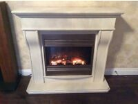 Electric fire and stone effect surround