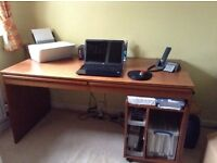 Large work desk with drawers and a pedestal
