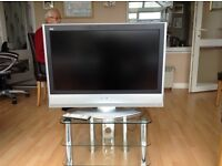 """Panasonic television LCD 32"""" on stand"""
