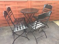 Black Metal garden furniture set. Table and four chairs. Fold away easily stored.