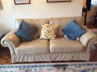Two leather three seater sofas
