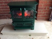 Electric coal effect cast iron stove and marble hearth