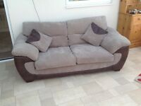 Two seater sofa and two cushions