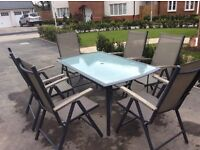 Patio Table and 6 Reclining Chairs