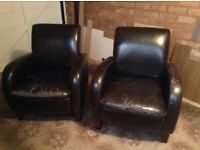 2 brown faux leather bucket chairs free to collector